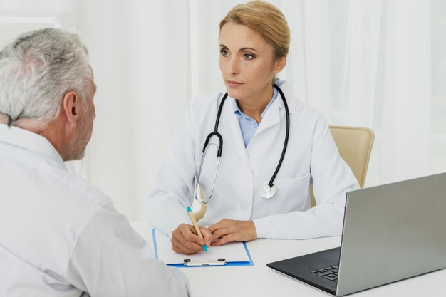 doctor-taking-notes-with-patient